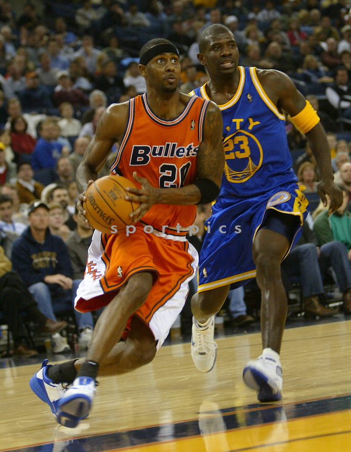 Larry Hughes, of the Washington Wizards  in action against the Golden State Warriors...Washington wins 103-101..Rob Holts / SportPics