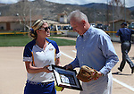 Western Nevada Wildcats Assistant Coach Bethany Henry-Herman presents WNC President Chet Burton with a memento after he threw out the first pitch at Edmonds Sports Complex, in Carson City, Nev., on Friday, April 18, 2014.<br /> Photo by Cathleen Allison/Nevada Photo Source