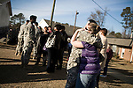 December 13, 2008. Erwin, North Carolina.. Soldiers said their goodbyes before getting o the buses to return to Ft. Bragg to complete their training.. A deployment ceremony was held at Cape Fear Christian Academy for B Company 230th Brigade Support Battalion headquartered in Dunn, NC.. The unit is part of the North Carolina National Guard's 30th Heavy Brigade Combat Team, which has 4000 soldiers  deploying to Iraq in April after training.The 30th was last deployed to Iraq in 2003-2005.