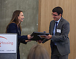 Ann Silverberg, Executive Vice President BRIDGE Housing Corporation, presents a framed plaque to Paul Carney, Vice President, Chase. The Rivermark Grand Opening, City of West Sacramento, Wednesday, June 10, 2015 in Sacramento, California.  Bridge Housing.  Photo/Victoria Sheridan