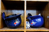 Toronto Blue Jays batting helmets in the dugout before a Spring Training game against the New York Yankees at Steinbrenner Field on February 28, 2013 in Tampa, Florida.  Toronto defeated New York 1-0.  (Mike Janes/Four Seam Images)