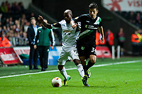 Thursday  03 October  2013  Pictured:( L-R )  Luke Moore of Swansea and Roberto Rodriguez of St.Gallen<br /> Re:UEFA Europa League, Swansea City FC vs FC St.Gallen,  at the Liberty Staduim Swansea
