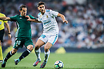 Marco Asensio Willemsen (r) of Real Madrid fights for the ball with Jose Andres Guardado Hernandez of Real Betis during the La Liga 2017-18 match between Real Madrid and Real Betis at Estadio Santiago Bernabeu on 20 September 2017 in Madrid, Spain. Photo by Diego Gonzalez / Power Sport Images