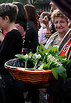 Woman with Lily of the Valley flowers, May Day March, Paris, 1 May 2009