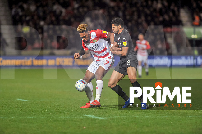 Barnsley's defender Zeki Fryers (3) holds up Doncaster Rovers forward Malik Wilks (7) during the Sky Bet League 1 match between Doncaster Rovers and Barnsley at the Keepmoat Stadium, Doncaster, England on 15 March 2019. Photo by Stephen Buckley / PRiME Media Images.