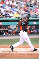 Miami Marlins second baseman Chone Figgins (1) follows through on his swing against the Houston Astros during a spring training game at the Roger Dean Complex in Jupiter, Florida on March 12, 2013. Houston defeated Miami 9-4. (Stacy Jo Grant/Four Seam Images)........