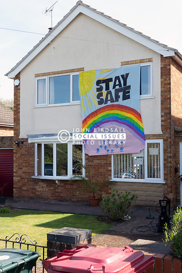 Stay safe support rainbow sign sign in residential area of Reading during Coronavirus lockdown, UK April 2020