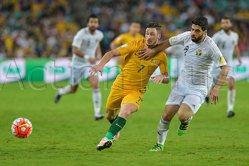 29.03.2016. Allianz Stadium, Sydney, Australia. Football 2018 World Cup Qualification match Australia versus Jordan. Australian forward Mathew Leckie is held back.  Australia won 5-1.