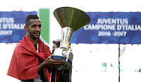 Calcio, Serie A: Juventus vs Crotone. Torino, Juventus Stadium, 21 maggio 2017.<br /> Juventus' Mehdi Benatia holds the trophy during the celebrations for the victory of the sixth consecutive Scudetto at the end of the Italian Serie A football match between Juventus and Crotone at Turin's Juventus Stadium, 21 May 2017. Juventus defeated Crotone 3-0.<br /> UPDATE IMAGES PRESS/Isabella Bonotto