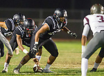 Lawndale, CA 09/29/17 - Jalen Hamler (Lawndale #15) and Keyahn Pinkston (Lawndale #55) in action during the Torrance vs Lawndale CIF Varsity football game at Lawndale High School.   Lawndale defeated Torrance 42-0.
