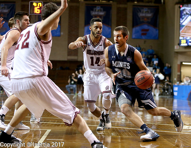 SIOUX FALLS, SD: MARCH 22: Luke Schroepfer #30 from Colorado Mines drives past Tyler Jenkins #14 from Bellarmine during the Men's Division II Basketball Championship Tournament on March 22, 2017 at the Sanford Pentagon in Sioux Falls, SD. (Photo by Dave Eggen/Inertia)