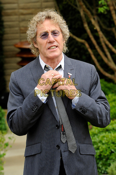 Roger Daltrey.The Chelsea Flower Show 2012, London, England..May 21st, 2012.half length grey gray white tie sunglasses shades suit hands.CAP/CJ.©Chris Joseph/Capital Pictures.