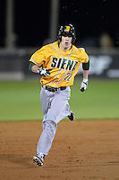 Siena Saints outfielder Dan Swain (22) runs the bases after hitting a home run during the season opening game against the Central Florida Knights at Jay Bergman Field on February 14, 2014 in Orlando, Florida.  UCF defeated Siena 8-1.  (Mike Janes/Four Seam Images)