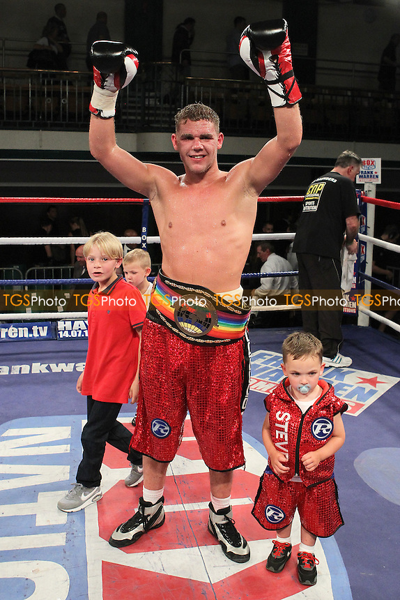 Billy Joe Saunders (red shorts) defeats Bradley Pryce in a Middleweight boxing contest for the Commonwealth Title at York Hall, Bethnal Green, London, promoted by Frank Warren- 01/06/12 - MANDATORY CREDIT: Gavin Ellis/TGSPHOTO - Self billing applies where appropriate - 0845 094 6026 - contact@tgsphoto.co.uk - NO UNPAID USE.