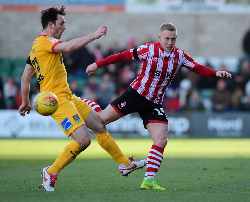 Lincoln City's Danny Rowe vies for possession with Northampton Town's John-Joe O'Toole<br /> <br /> Photographer Chris Vaughan/CameraSport<br /> <br /> The EFL Sky Bet League Two - Lincoln City v Northampton Town - Saturday 9th February 2019 - Sincil Bank - Lincoln<br /> <br /> World Copyright © 2019 CameraSport. All rights reserved. 43 Linden Ave. Countesthorpe. Leicester. England. LE8 5PG - Tel: +44 (0) 116 277 4147 - admin@camerasport.com - www.camerasport.com