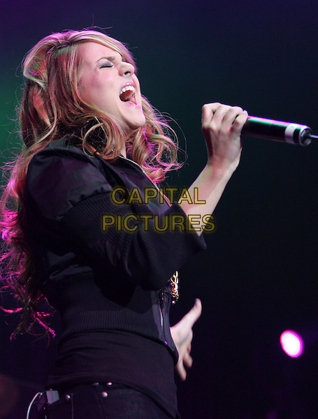JOJO.performs live at The KIIS FM Jingle Ball 2006 held at The Honda Center in Anaheim, California, USA,.December 07 2006..half length music concert gig live on stage mouth open.CAP/DVS.©Debbie VanStory/Capital Pictures