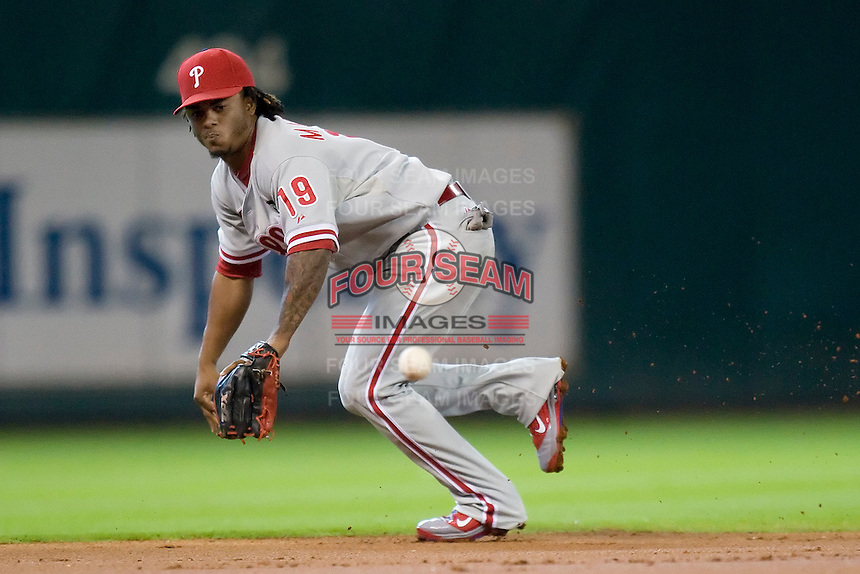 Philadelphia Phillies shortstop Michael Martinez #19 on defense during the Major League Baseball game against the Houston Astros at Minute Maid Park in Houston, Texas on September 14, 2011. Philadelphia defeated Houston 1-0 to clinch a playoff berth.  (Andrew Woolley/Four Seam Images)