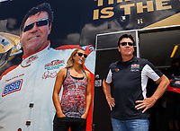 Jul 8, 2017; Joliet, IL, USA; NHRA top fuel driver Leah Pritchett (left) and Papa Johns Pizza founder John Schnatter during qualifying for the Route 66 Nationals at Route 66 Raceway. Mandatory Credit: Mark J. Rebilas-USA TODAY Sports