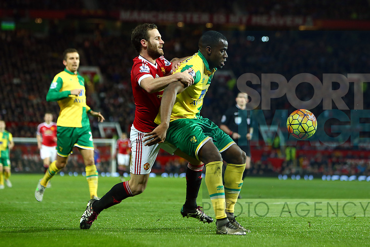 Juan Mata of Manchester United battles Norwich's Sebastian Bassong - Manchester United vs Norwich City - Barclays Premier League - Old Trafford - Manchester - 19/12/2015 Pic Philip Oldham/SportImage