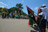 July 9, 2011 (Washington, DC)  Protestors for and against NATO bombing in Libya clash in front of the White House.  Opponents consider U.S. military action in Libya unjustified and illegal.  Those in favor military action believe the bombing is necessary to oust Gaddafi.  As the intensity of the rally increased, police moved barricades between the two groups to keep them separated. (Photo by Don Baxter/Media Images International)