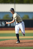 Wake Forest Demon Deacons starting pitcher Carter Bach (18) follows through on his delivery against the Liberty Flames at David F. Couch Ballpark on April 25, 2018 in  Winston-Salem, North Carolina.  The Demon Deacons defeated the Flames 8-7.  (Brian Westerholt/Four Seam Images)