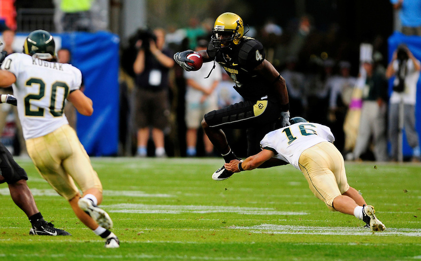 31 Aug 2008: Colorado wide receiver Patrick Williams tries to avoid a tackle by Colorado State safety Jake Galusha. The Colorado Buffaloes defeated the Colorado State Rams 38-17 at Invesco Field at Mile High in Denver, Colorado. FOR EDITORIAL USE ONLY