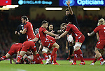 Wales scrum half Rhys Webb clears the ball from the back of the breakdown.<br /> Dove men Series 2014<br /> Wales v New Zealand<br /> 22.11.14<br /> &copy;Steve Pope -SPORTINGWALES