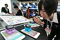 An exhibitor talks with a ''Smapon,'' Takara Tomy's smartphone application at the International Tokyo Toy Show 2016 in Tokyo Big Sight on June 9, 2016, Tokyo, Japan. The annual exhibition showcases some 35,000 toys from 160 toy makers from Japan and overseas. The show runs to June 12th and organisers expect to attract 160,000 visitors. (Photo by Rodrigo Reyes Marin/AFLO)