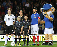 Team captains Chris Higgins (left) and Lee McCulloch with match referee Stevie O'reilly and match mascots and Broxi Bear in the Rangers v Queen of the South Quarter Final match in the Ramsdens Cup played at Ibrox Stadium, Glasgow on 18.9.12.