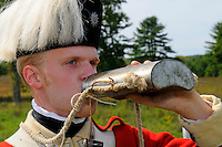 Soldier of His Majesty's 62nd Regiment of Foot drinks from his tin canteen after marching exercises at a Revolutionary War encampment at Freeman's Farm, site of a major British defeat in September 1777, Saratoga National Historical Park, Stillwater, New York, USA.