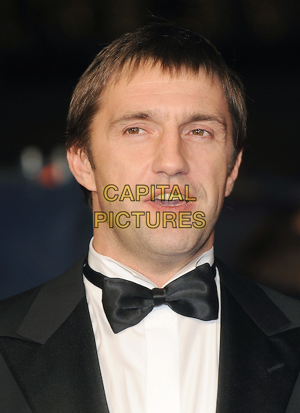 Vladimir Vdovichenkov.'360' opening gala premiere, 55th BFI London Film Festival, Odeon cinema, Leicester Square, London, England..October 12th 2011.headshot portrait black tuxedo bow tie white shirt mouth open.CAP/BEL.©Tom Belcher/Capital Pictures.