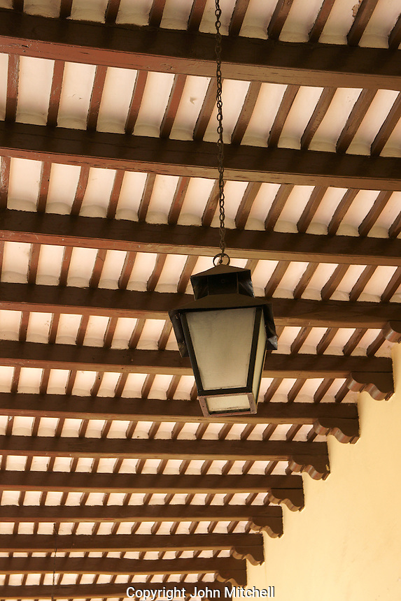 Lantern and wooden  beamed ceiling of a Spanish colonial building in Merida, Yucatan, Mexico.