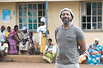 Comic relief 2015 Lenny Henry visit <br /> <br /> lenny with the clinic behind
