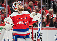 WASHINGTON, DC - JANUARY 31: Braden Holtby #70 of the Washington Capitals  looks up at the video screen after the first Islander goal during a game between New York Islanders and Washington Capitals at Capital One Arena on January 31, 2020 in Washington, DC.