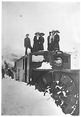 D&amp;RG rotary snowplow #ON with six people, two crew and four ladies, standing on top during a break in the action.<br /> D&amp;RG  Irwin - Floresta Branch - Irwin Siding, CO  Taken by Wright, Frank - 1909