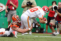 Bengals defensive end Justin Smith tackles Chiefs quarterback Trent Green for a quarterback sack in the second quarter at Arrowhead Stadium in Kansas City, Missouri on September 10, 2006. Cincinnati won 23-10.