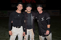 (L-R) Blake Rutherford, Jake Burger, and Casey Schroeder pose for a photo following the win over the Greensboro Grasshoppers at Kannapolis Intimidators Stadium on September 8, 2017 in Kannapolis, North Carolina.  The Intimidators defeated the Grasshoppers to sweep the South Atlantic League Northern Division playoffs in two games.  (Brian Westerholt/Four Seam Images)