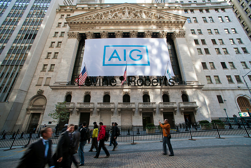A banner for the American International Group (AIG) decorates the front of the New York Stock Exchange in New York on Tuesday, October 16, 2012. The insurance giant is celebrating tis new logo and the company's continued progress.  (© Richard B. Levine)