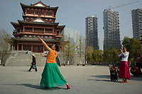 Huanggang, Hebei province, China - A dancer performs for her friends at the Yiai Park which was built to commemorate Song dynasty poet and politician Su Dongpo, October 2014.
