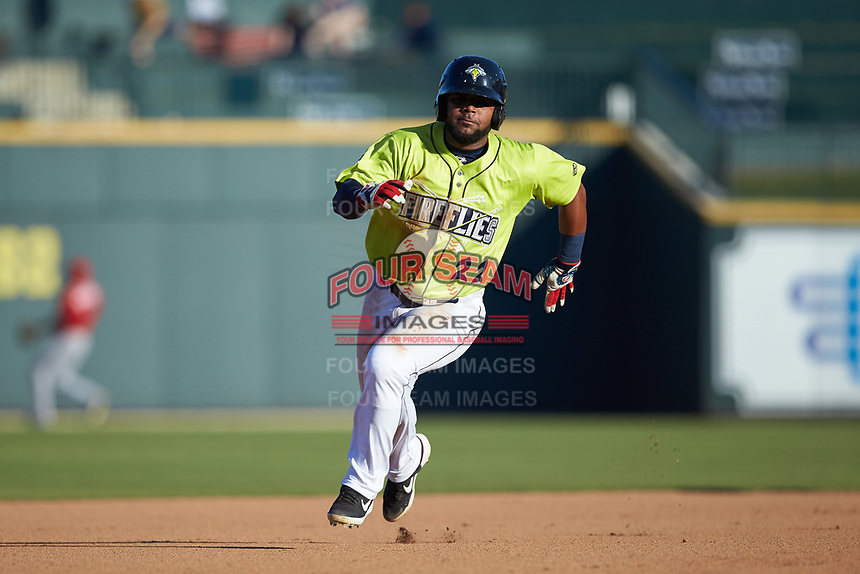 Walter Rasquin (22) of the Columbia Fireflies hustles towards third base against the Rome Braves at Segra Park on May 13, 2019 in Columbia, South Carolina. The Fireflies walked-off the Braves 2-1 in game one of a doubleheader. (Brian Westerholt/Four Seam Images)