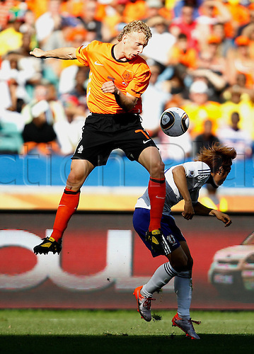 19 06 2010  Netherlands Dirk Kuyt Top vies with A Player of Japan during their 2010 World Cup Group E Soccer Match AT Moses Mabhida Stage in Durban South Africa ON June 19 2010