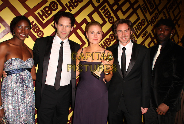 CAST OF TRUE BLOOD - (L-R) Actors Rutina Wesley, Stephen Moyer, Anna Paquin, Sam Trammell and Nelsan.2009 HBO Golden Globe After-Party held at Circa 55 Restaurant in The Beverly Hilton Hotel, Beverly Hills, California, USA, 11 January 2009.half length award winner trophy .CAP/ADM/KB.©Kevan Brooks/Admedia/Capital PIctures