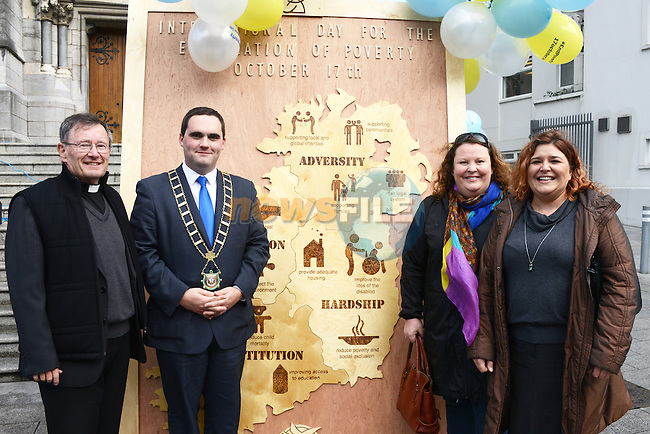 Mayor Kevin Callan and Monsignor Jim Carroll with Louise Mahony and Alison Digney of the Louth Community Drug and Alcohol Team at the unveiling ceremony to mark International Eradicate Poverty Day.