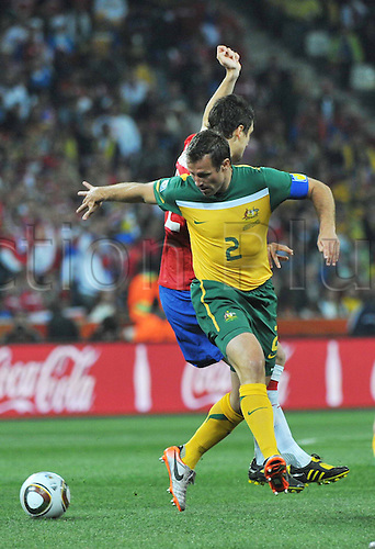 24 06 2010 Australia's Lucas Neill vies for The Ball  The FIFA World Cup, Group D, Australia v Serbia, Nelspruit Saush Africa, June 23rd 2010.