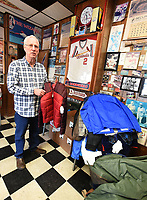 NWA Democrat-Gazette/FLIP PUTTHOFF <br /> COATS FOR ALL<br /> Gary Townzen shows Tuesday Nov. 27 2018 some of the coats for children and adults donated so far at his barbershop, Townzen Barbershop, at First and Walnut streets in downtown Rogers. Townzen has held an annual coat drive for 27 years. New coats or  coats in excellent condition can be donated at the barbershop. Coats are distributed through Samaritan Community Center and the Rogers school district.