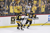 8th June 2017, Pittsburgh, PA, USA; Pittsburgh Penguins right wing Bryan Rust (17) celebrates his goal with defenseman Olli Maatta (3) during the first period in Game Five of the 2017 NHL Stanley Cup Final between the Nashville Predators and the Pittsburgh Penguins on June 8, 2017, at PPG Paints Arena