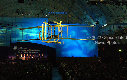 """Chantilly, VA - December 11, 2003 -- A replica of the 1903 Wright Brothers airplane """"flies"""" over the audience to close the dedication ceremony of the Steven F. Udvar-Hazy Center in Chantilly, Virginia on December 11, 2003.  This new air and space museum opens to the public on Monday, December 15, 2003..Credit: Ron Sachs / CNP.(RESTRICTION: NO New York or New Jersey Newspapers or newspapers within a 75 mile radius of New York City)"""