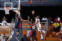 25 February 2012:  FIU guard Jeremy Allen (32) shoots over South Alabama center Augustine Rubit (21) and guard Wendell Wright (10) in the first half as the FIU Golden Panthers defeated the University of South Alabama Jaguars, 81-74, at the U.S. Century Bank Arena in Miami, Florida.