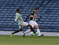 Darnell Fisher tackles Grant Munro in the Dunfermline Athletic v Celtic Scottish Football Association Youth Cup Final match played at Hampden Park, Glasgow on 1.5.13. ..