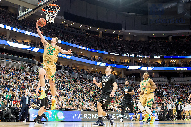 Mar. 21, 2015; Steve Vasturia (32) goes up for a shot in the third round game of the NCAA Tournament. Notre Dame defeated Butler 67-64 in overtime. (Photo by Matt Cashore/University of Notre Dame)